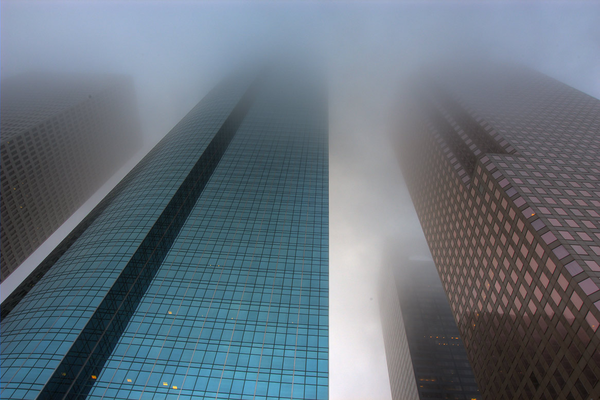 Wells Fargo Plaza and 1100 Louisiana buildings...Lamar streets in fog. Houston, Texas