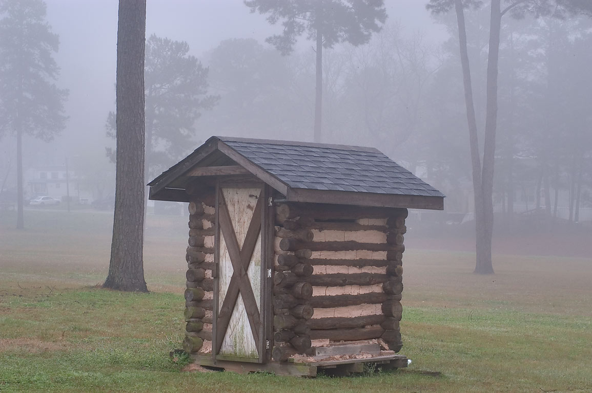 Outhouse of TDCJ Captain Joe Byrd (Peckerwood Hill) Cemetery in fog. Huntsville, Texas
