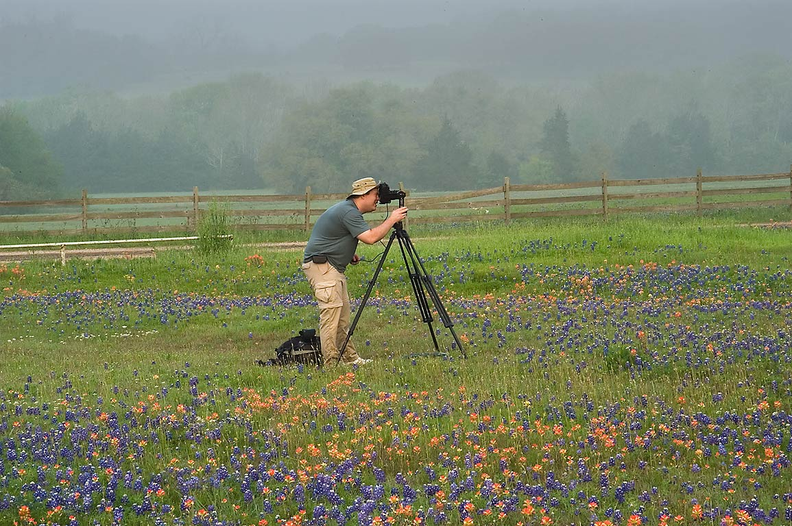 Photographer in Old Baylor Park at morning. Independence, Texas