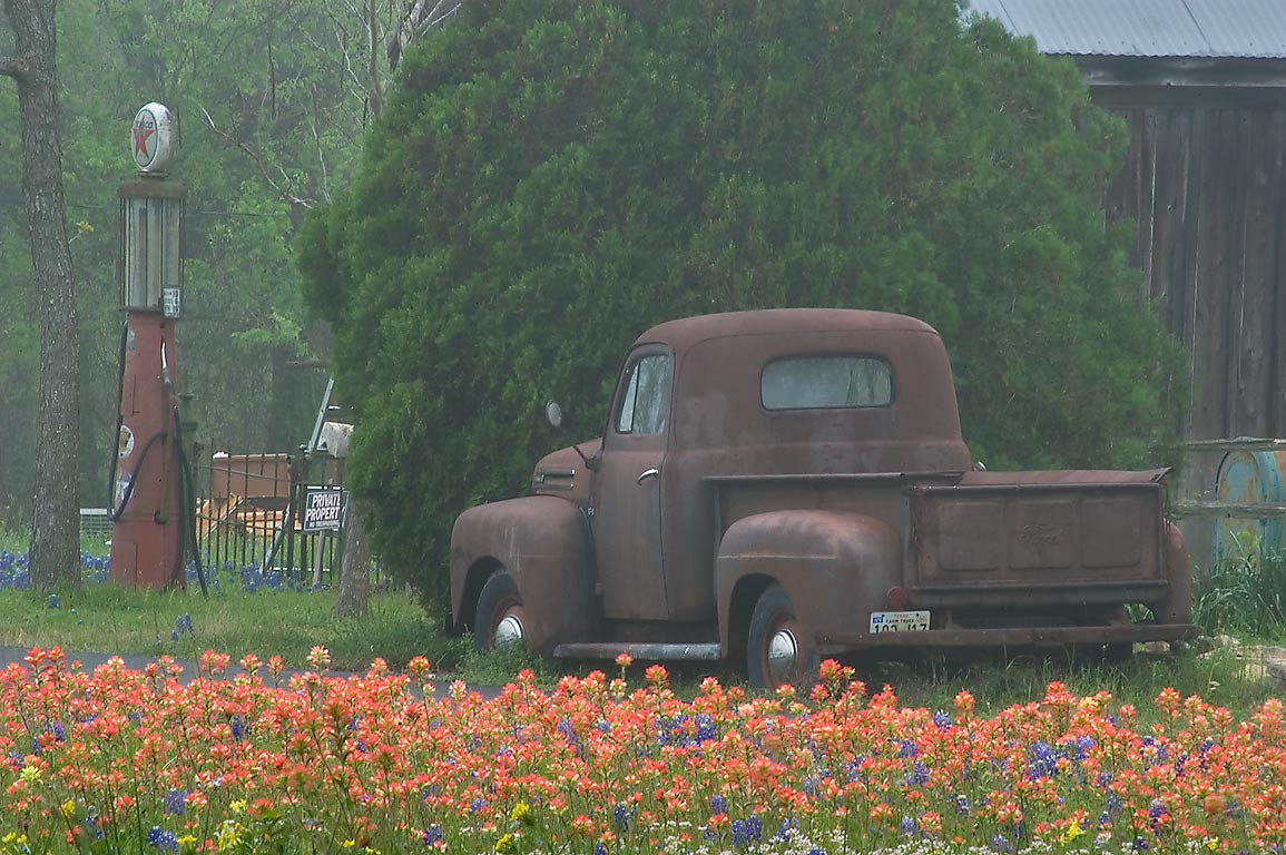 Paintbrush flowers and vintage car near Gilmartin...Old Baylor Park. Independence, Texas