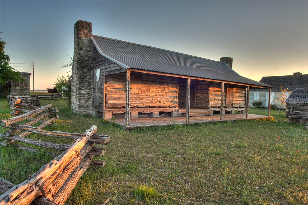 Log cabin in Old Bailor Park at sunrise. Independence, Texas