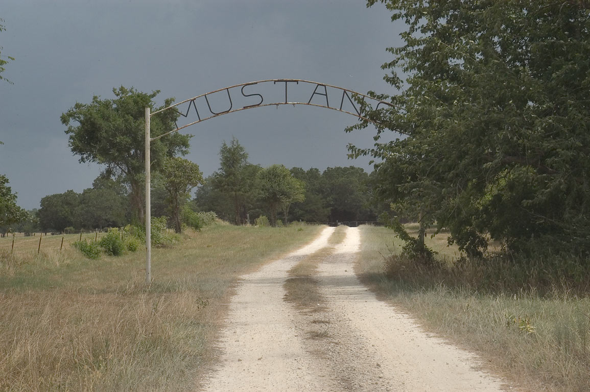 Gate of Mustang Cemetery at Rd. 227 near Rd. 30 west from Huntsville. Texas