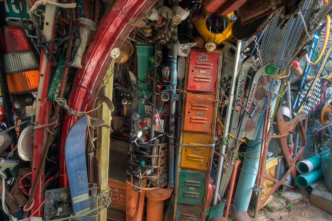 Colorful gate in Cathedral of Junk at 4422...s backyard folk art). Austin, Texas