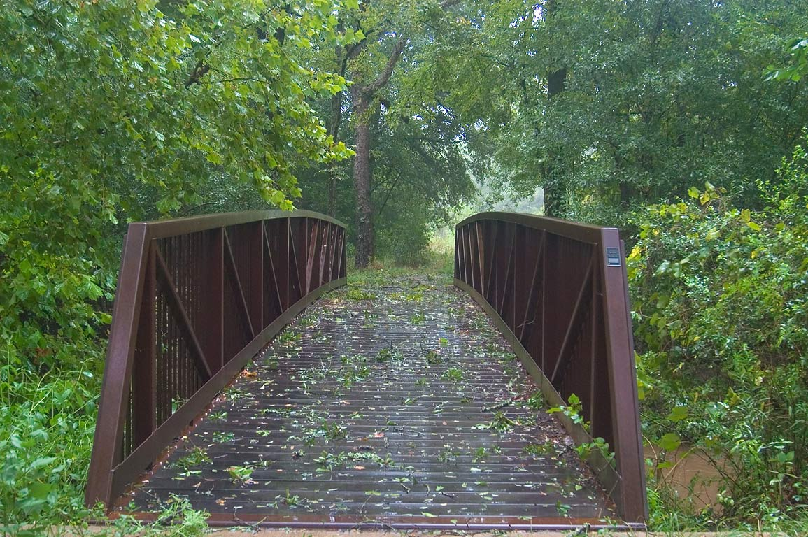 "Iron bridge in Lick Creek Park during a tropical storm ""Ike"". College Station, Texas"