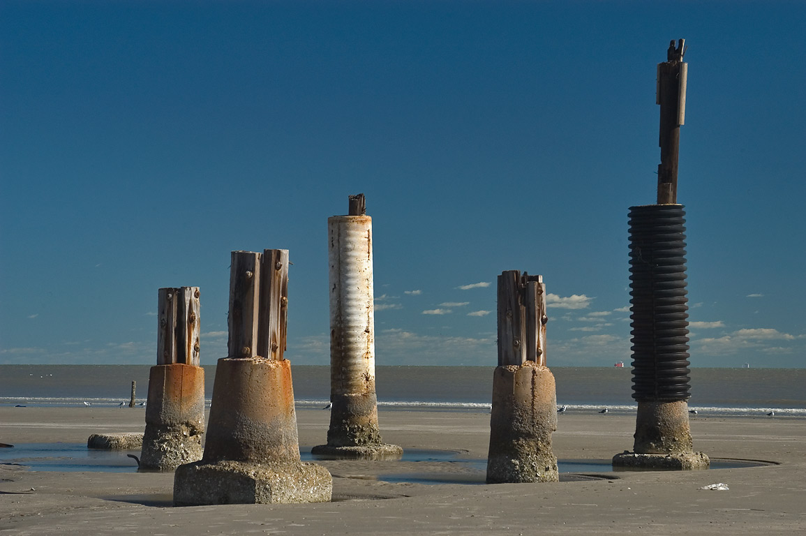 "Totem poles"", oddly shaped pilings remained from...a hurricane Ike. Galveston, Texas"