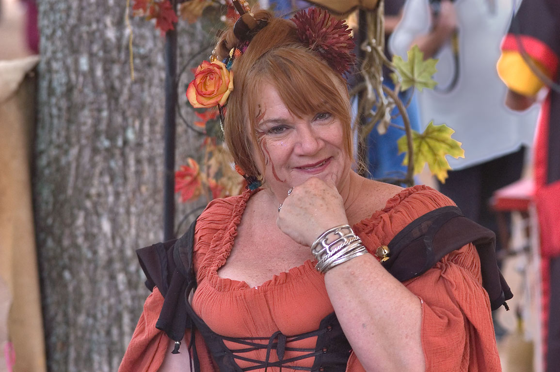 Staged smile of a dressed actor at Texas Renaissance Festival. Plantersville, Texas