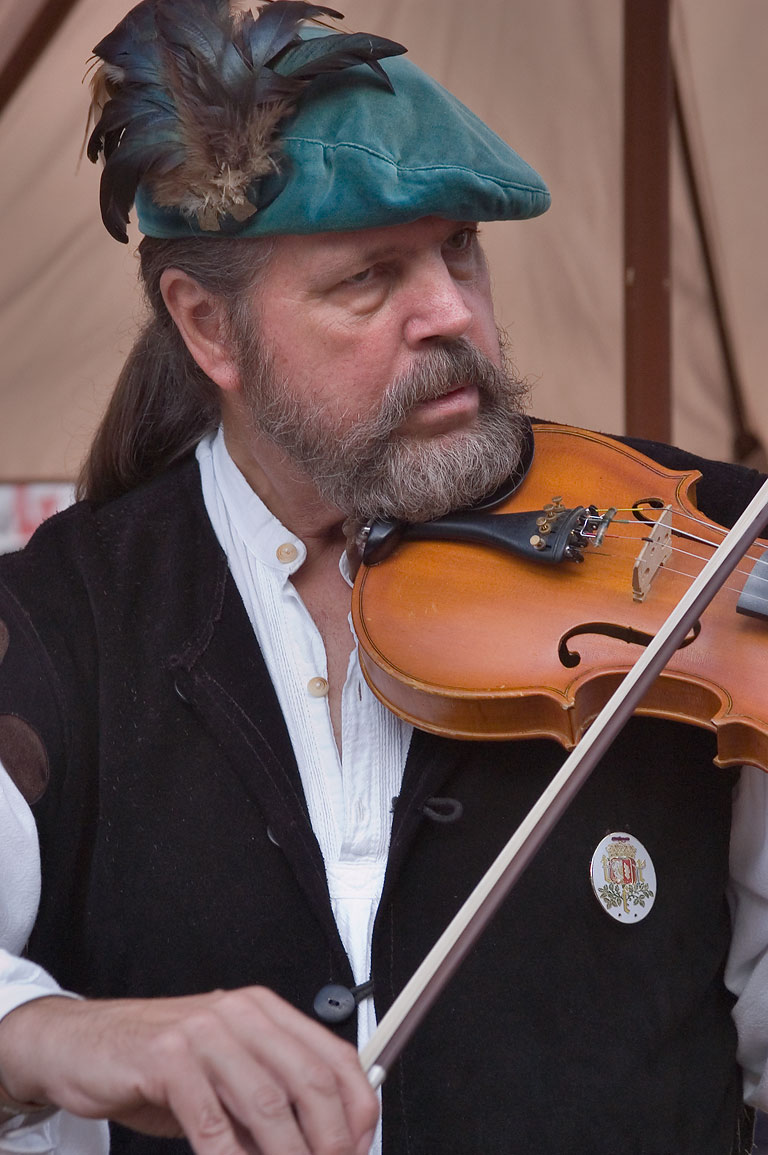 Performer with a violin at Texas Renaissance Festival. Plantersville, Texas