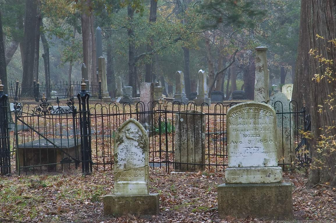 Tombs of Oakwood Cemetery in mist. Huntsville, Texas