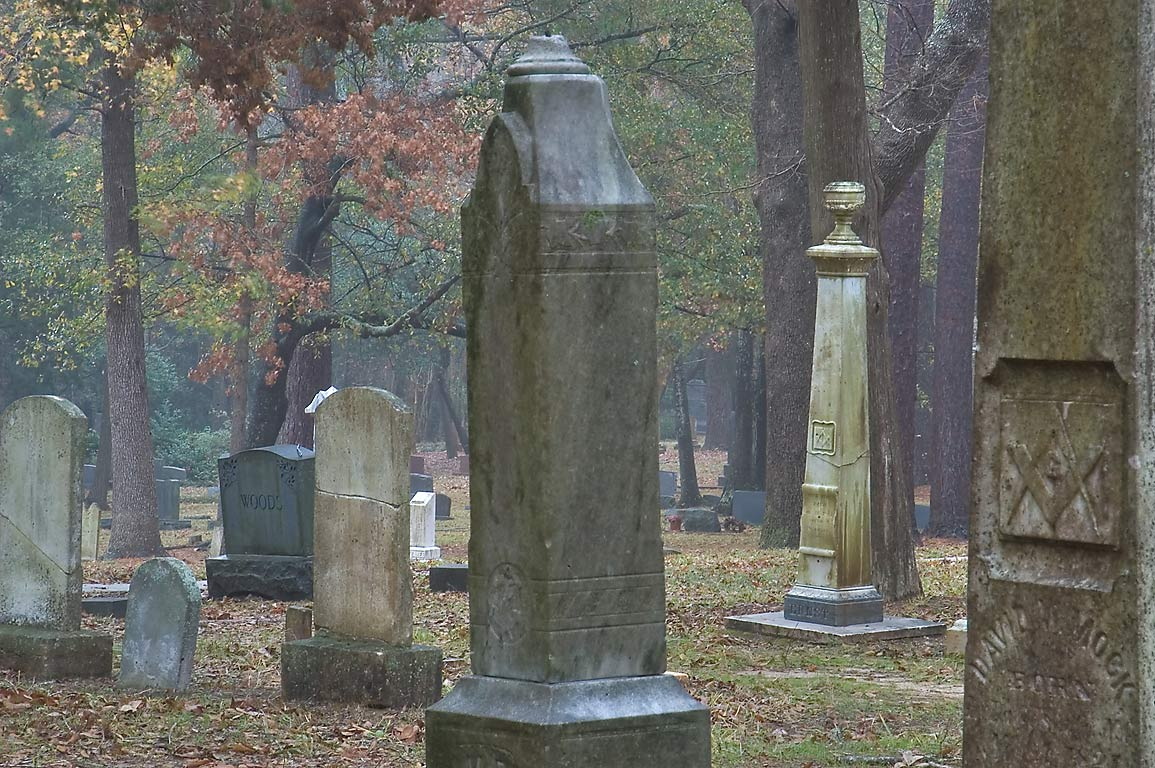 Headstones of Oakwood Cemetery in mist. Huntsville, Texas