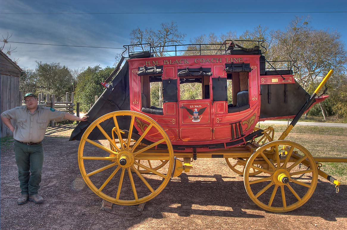 Red replica of 1850 Concord stagecoach near Fanthorp Inn. Anderson, Texas