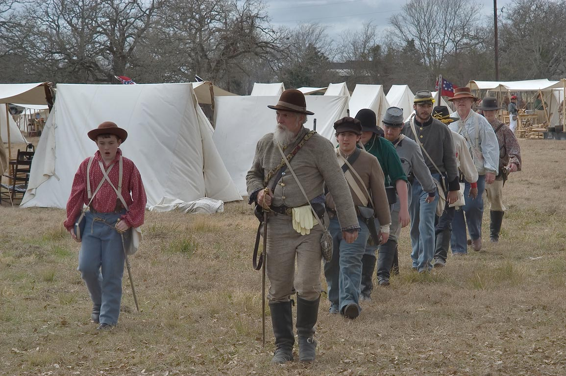Marching soldiers at third annual 8th Texas...at Lake Madison. Madisonville, Texas
