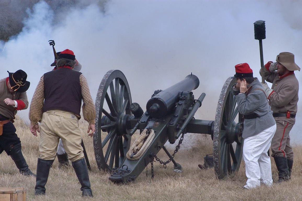 Firing from a cannon of Confederate artillery at...at Lake Madison. Madisonville, Texas