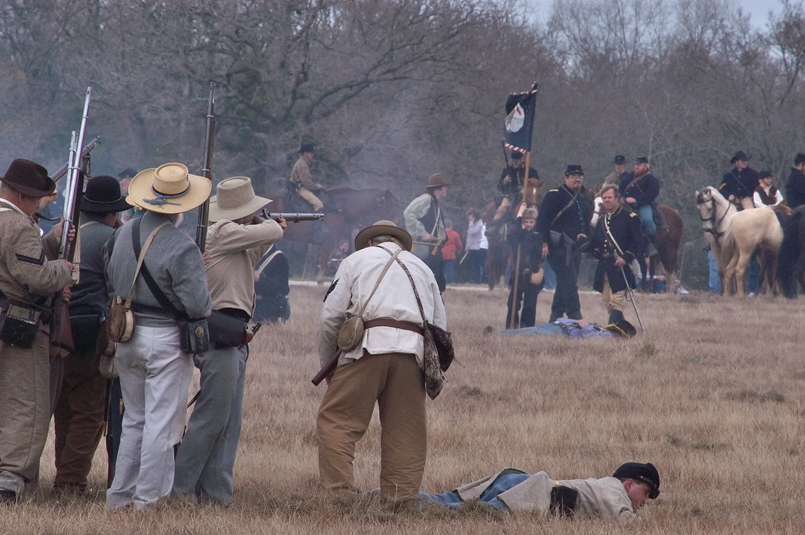 Confederate infantry shooting at Union soldiers...at Lake Madison. Madisonville, Texas