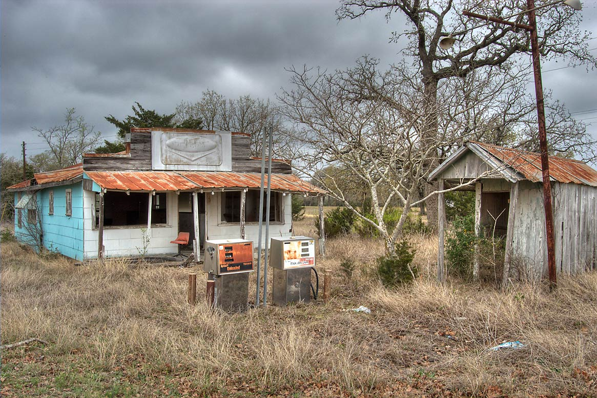 Abandoned gas station and a grocery store at a...Rd. south-west from Somerville. Texas