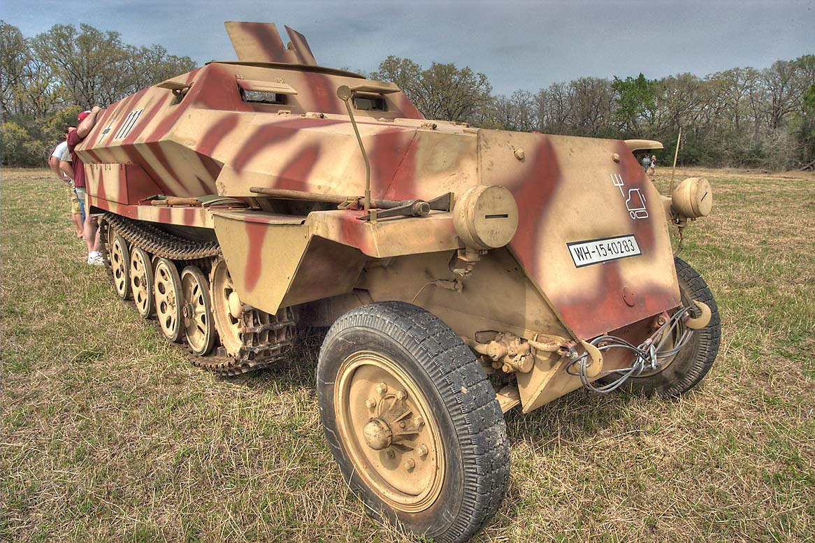 World War II German half track at WWII re...American GI. College Station, Texas