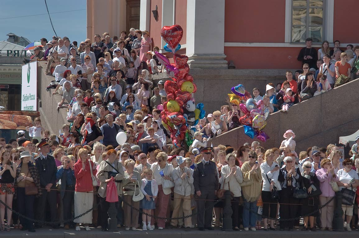 Crowds watching Day of the City parade on Nevsky...Duma Watchtower. St.Petersburg, Russia