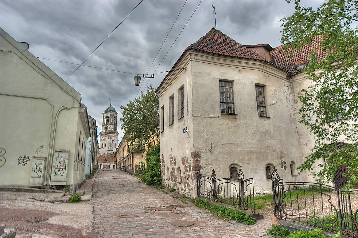 Vodnoy Zastavy (Watergate) Street, with St...Tower in background. Vyborg, Russia