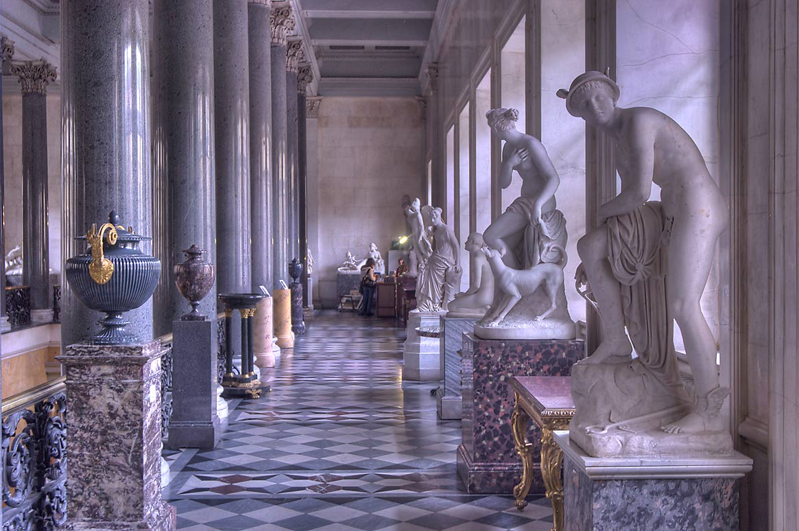 Marble statues near Main Staircase of New...Museum. St.Petersburg, Russia