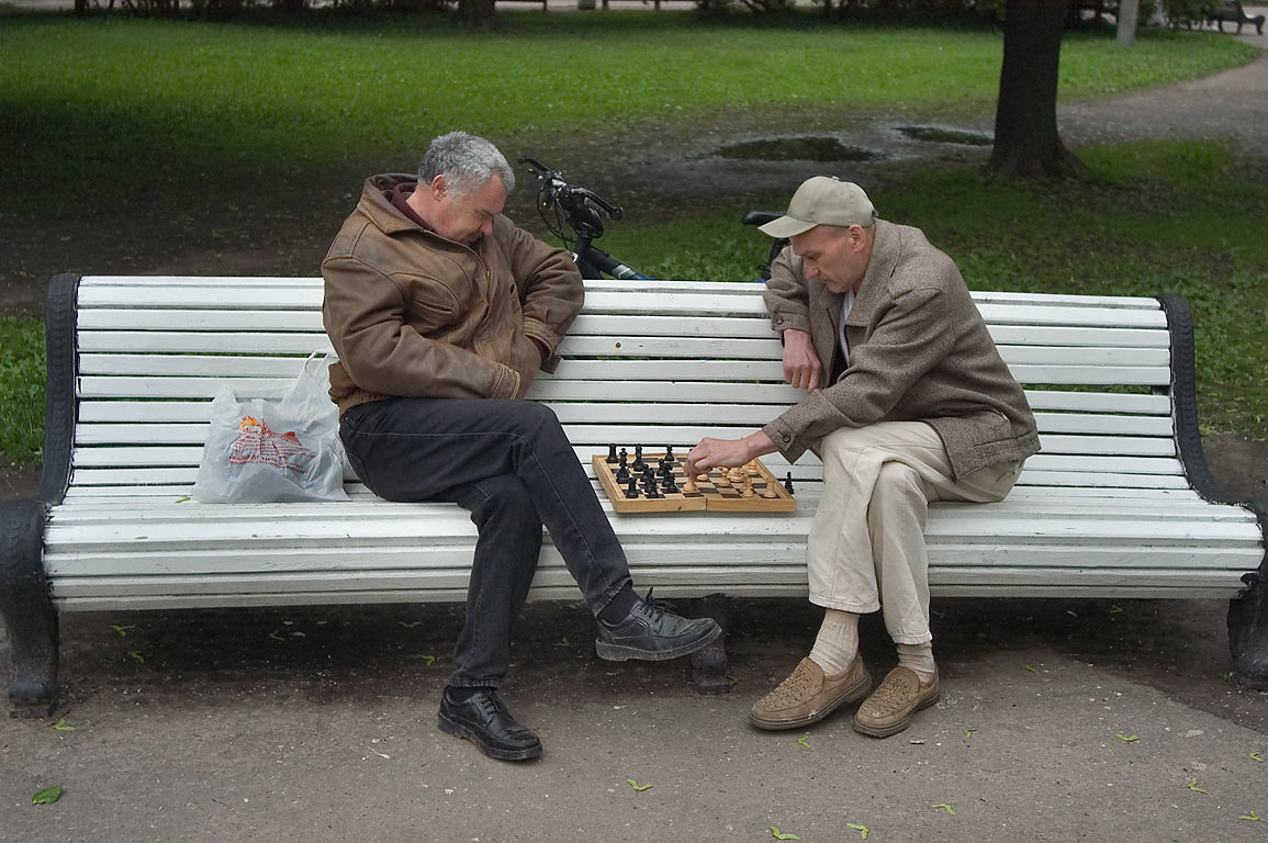 Playing chess on a bench in Moskovsky Pobedy Park. St.Petersburg, Russia