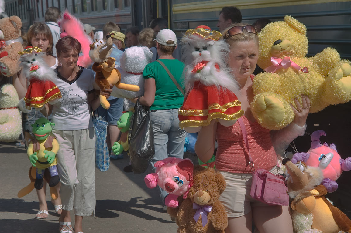 Merchants with colorful soft toy animals on a...its artificial fur factory. Belorussia