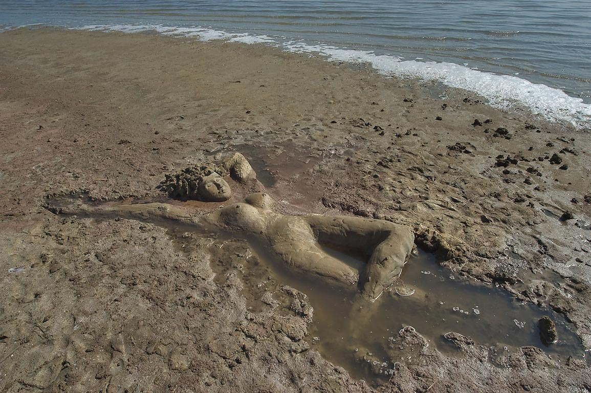 Beach mud sculpture on shores of Kuyalnik Liman. Odessa, Ukraine