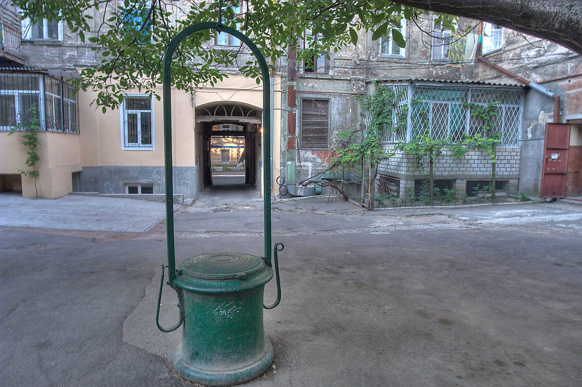 Old water well in a courtyard at 4 Bogdanova Pereulok. Odessa, Ukraine