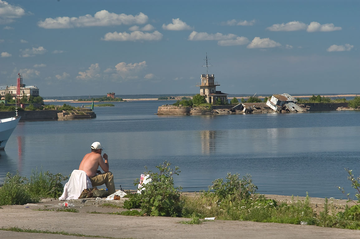 Fishing from Petrovsky Dock Channel. Kronstadt (part of St.Petersburg), Russia