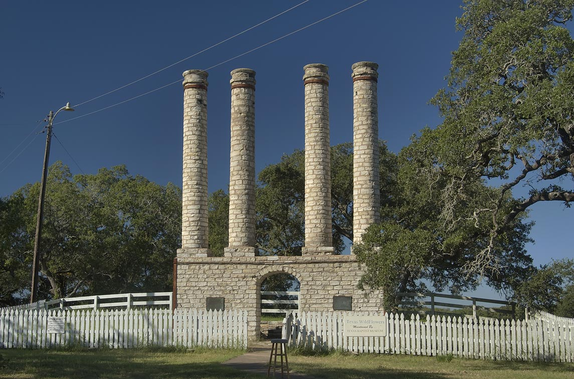 Four tall stone columns remaining from front...University Park. Independence, Texas