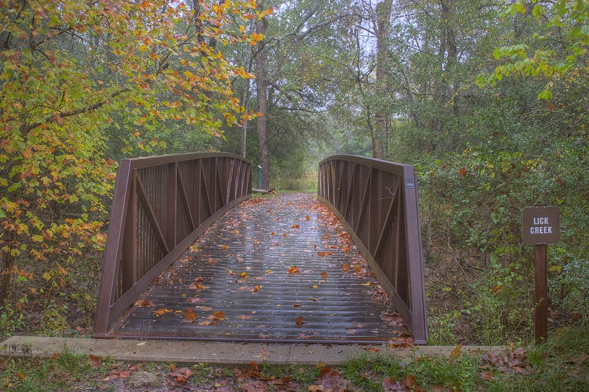 Bridge of Deer Run Trail in Lick Creek Park. College Station, Texas