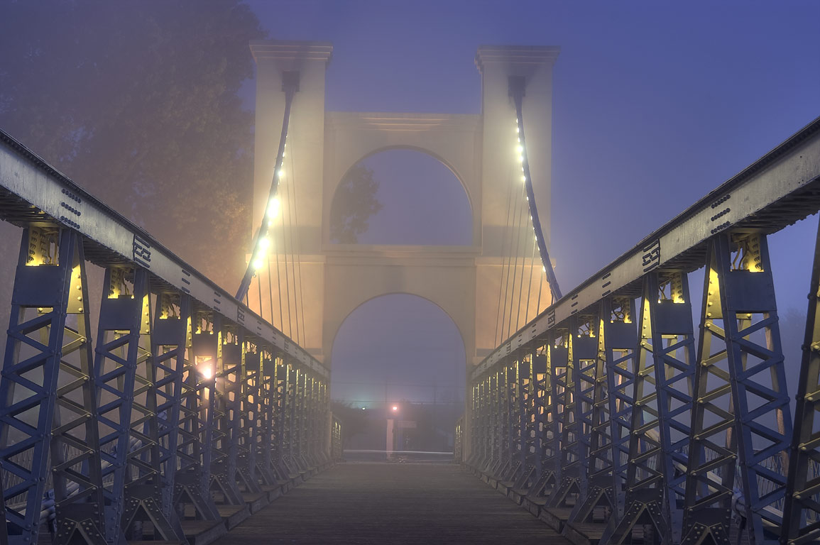 Waco Suspension Bridge in fog. Waco, Texas