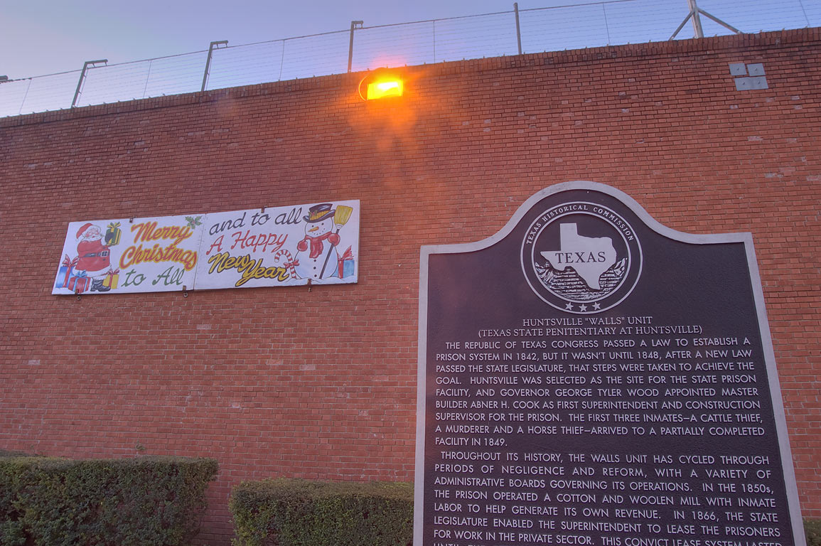 "Christmas decoration on tall brick security walls...prison ""The Walls"". Huntsville, Texas"