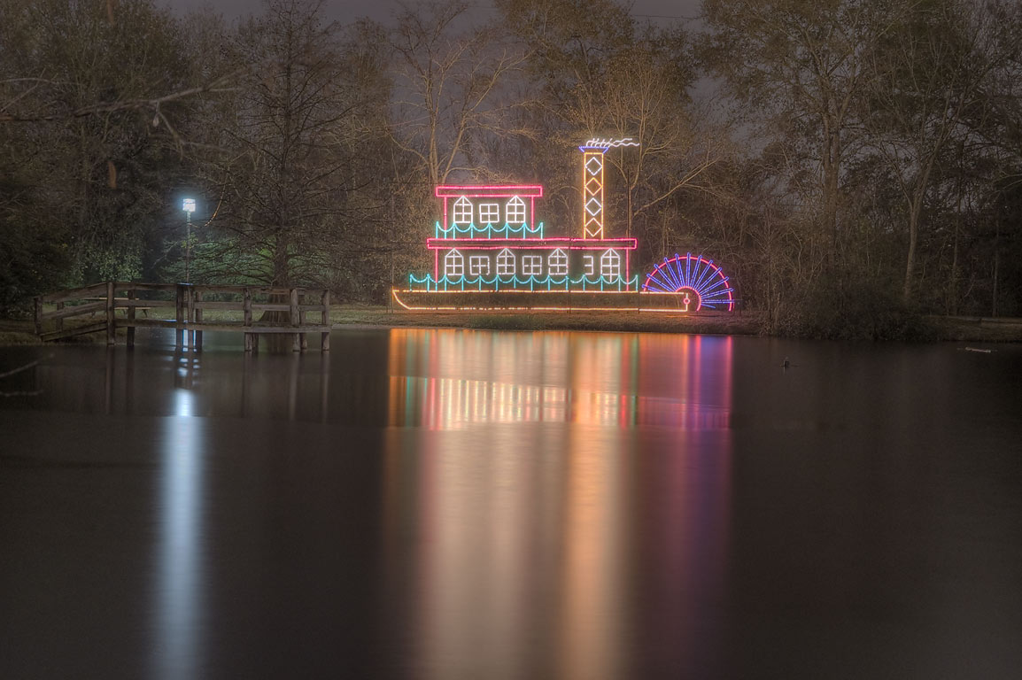 Steamboat Christmas light decoration on a pond in Central Park. College Station, Texas