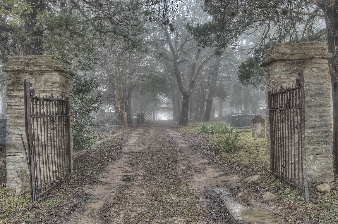 Gates of Odd Fellow Cemetery in fog. Anderson, Texas