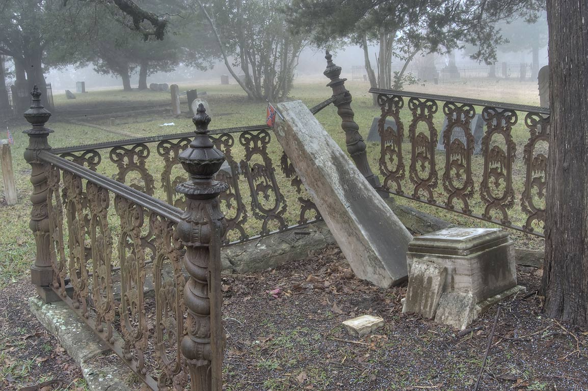 Cast iron fence of a tomb in Odd Fellow Cemetery. Anderson, Texas
