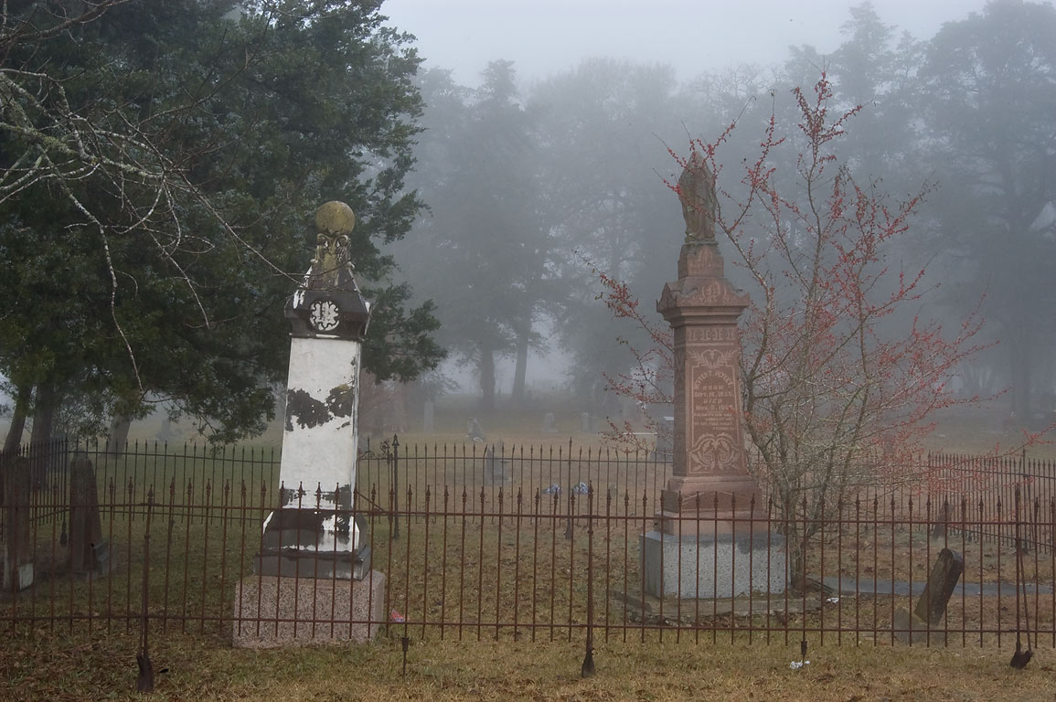 Tombs of Odd Fellow Cemetery in fog. Anderson, Texas