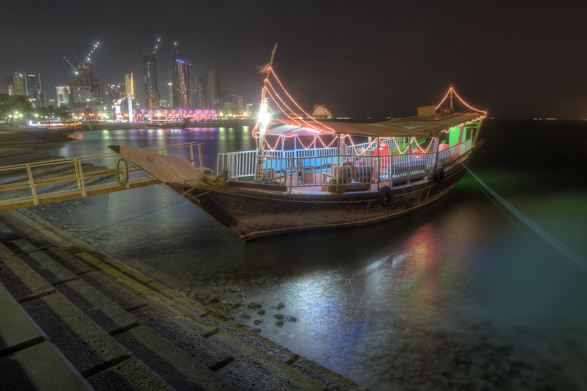 Dhow boat near Corniche (waterfront promenade) at evening. Doha, Qatar