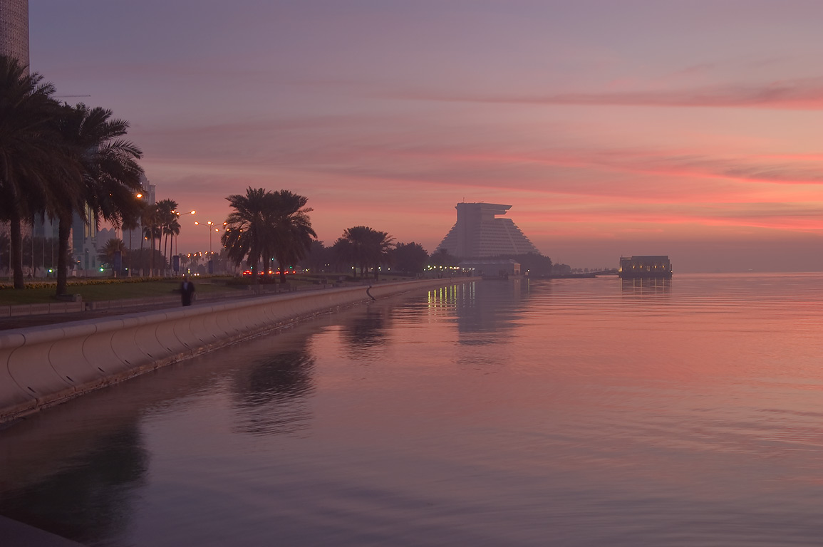 Sheraton Hotel at the far end of the Corniche (seafront promenade) at morning. Doha, Qatar