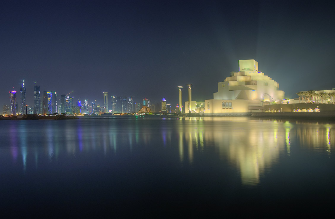 Museum of Islamic Art built on artificial island from Corniche at evening. Doha, Qatar