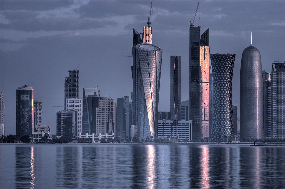 West Bay towers reflected in harbor from Corniche. Doha, Qatar