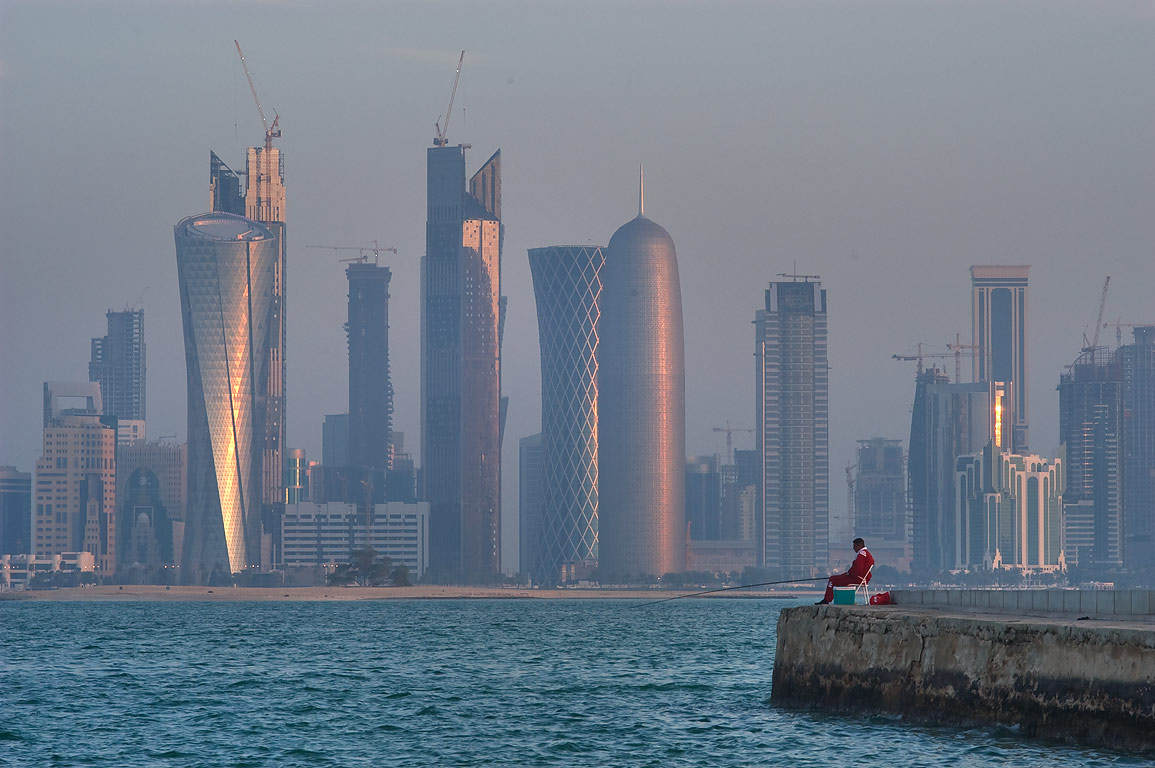 Fishing from a mall at Corniche at sunrise. Doha, Qatar