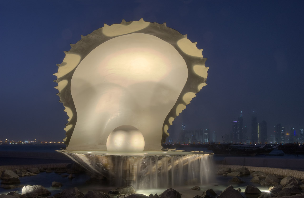 Oyster and Pearl sculpture at evening dusk. Doha, Qatar