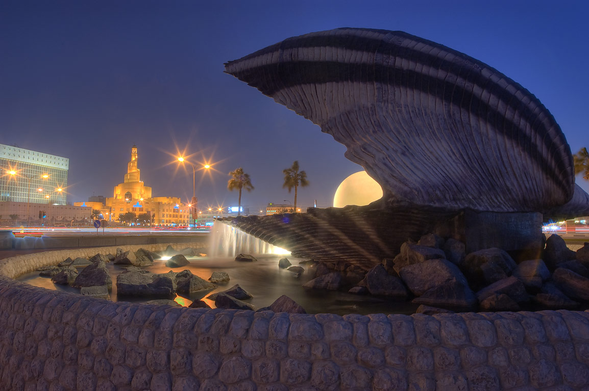 Oyster with a pearl statue, with spiral mosque in background. Doha, Qatar