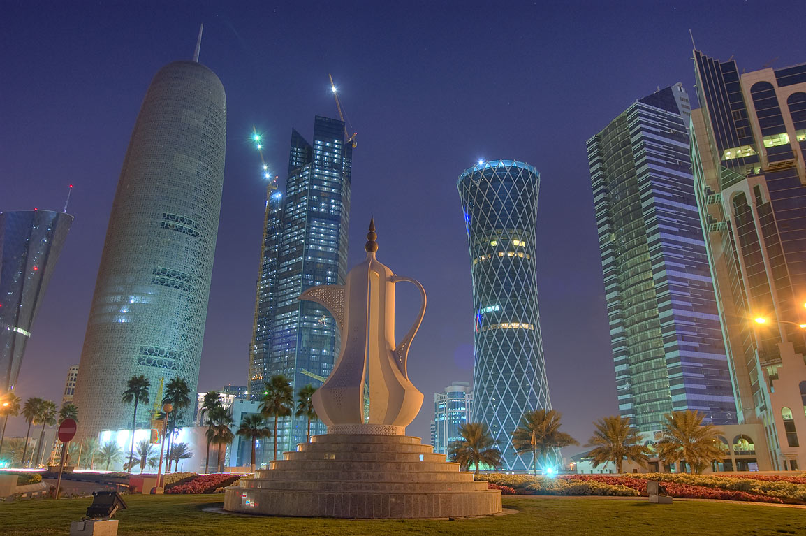 Giant teapot sculpture (dallah, or coffee pot...Bay towers from Corniche. Doha, Qatar