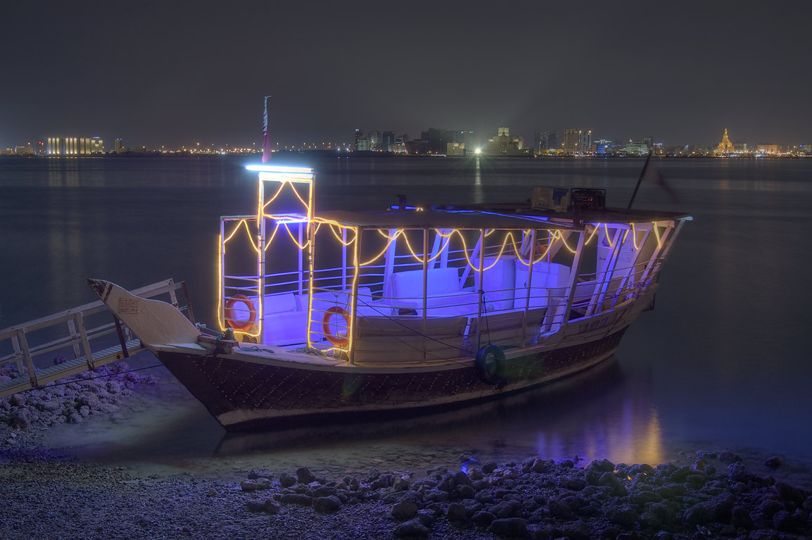 Illuminated dhow boat at Corniche. Doha, Qatar