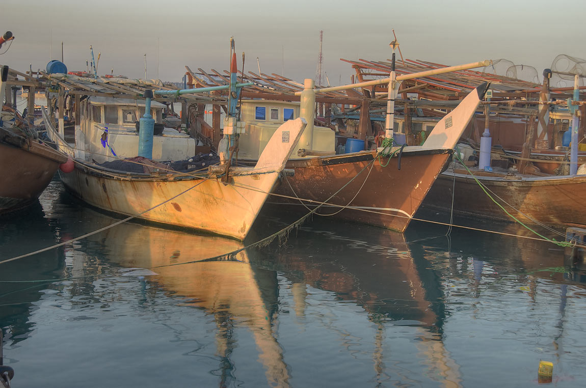 Dhow boats at sunrise in fishing harbor of Al Wakra, south from Doha. Qatar