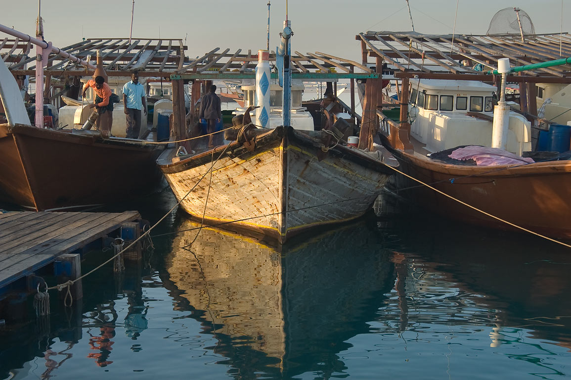 Fishermen on dhow boats at morning in harbor of Al Wakra, south from Doha. Qatar