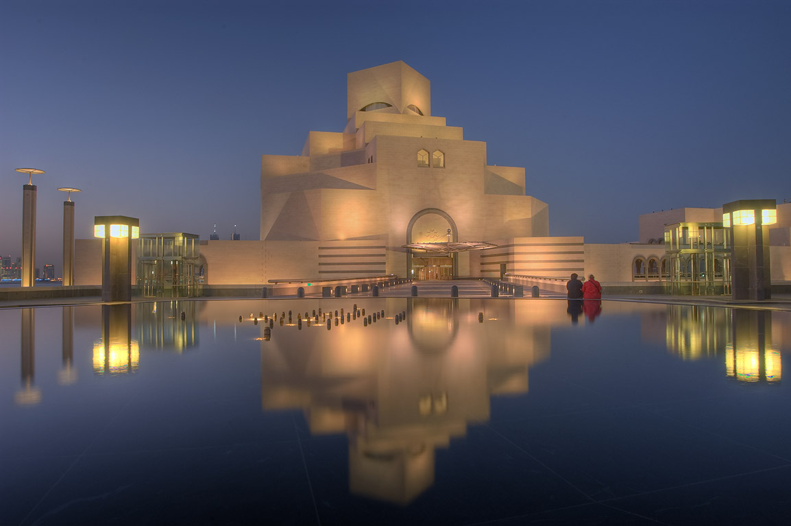 Main building entrance facade of Museum of Islamic Art at evening. Doha, Qatar