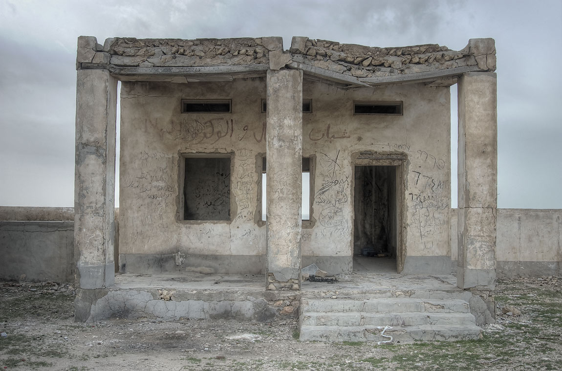 Stone building of the village school in ruined...of Ruwais on northwest coast. Qatar