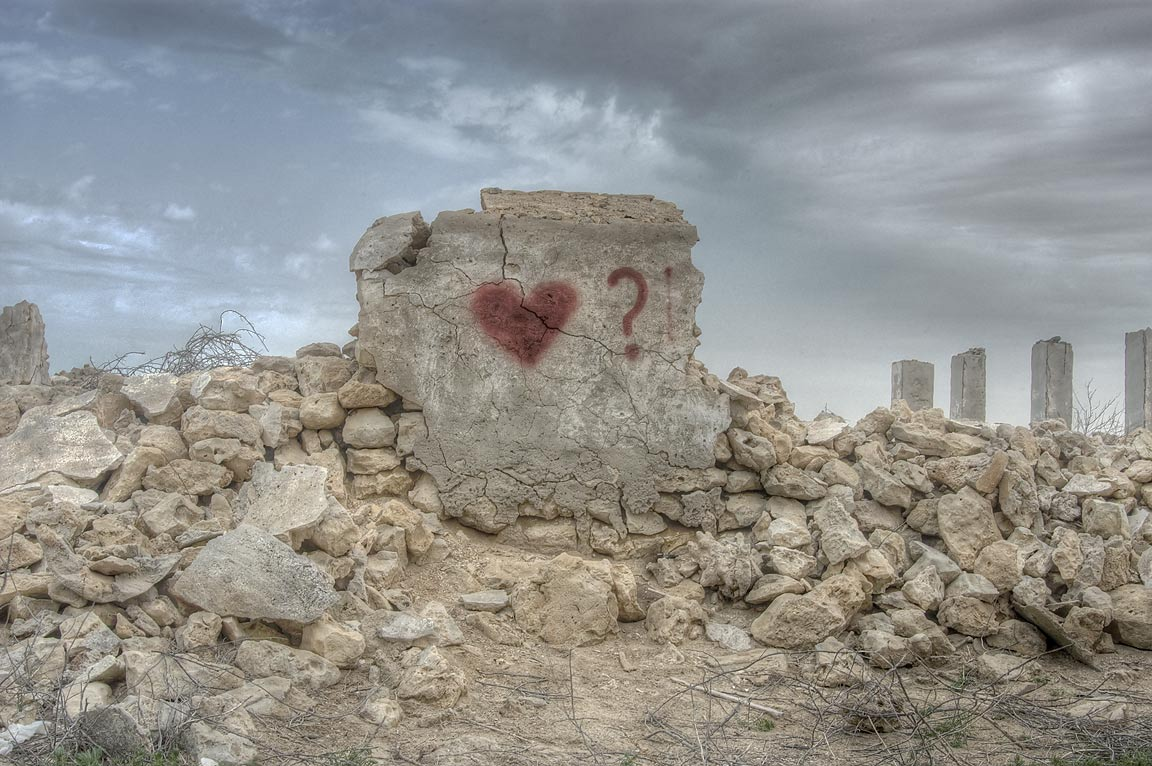 Graffiti on stone walls in ruined village of Al...of Ruwais on northwest coast. Qatar