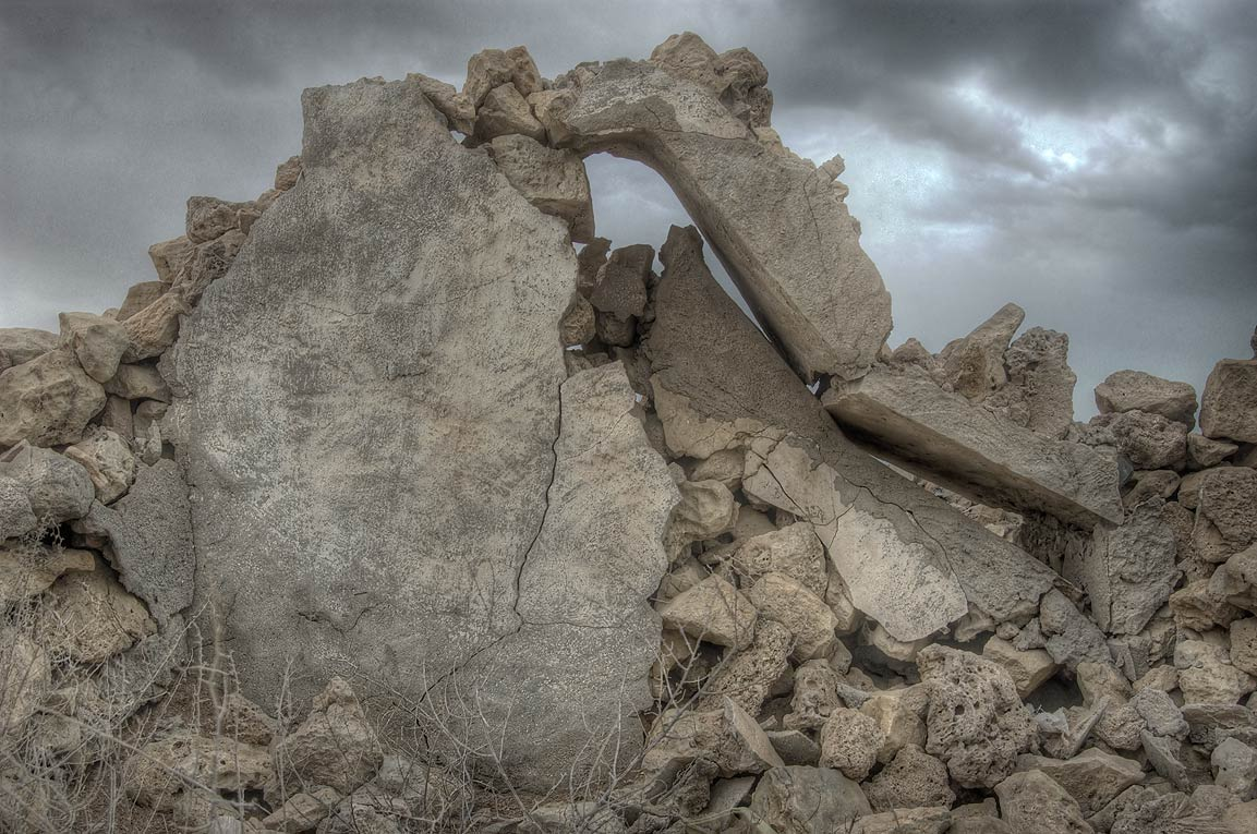 Broken stone walls in a ruined village of Al...of Ruwais on northwest coast. Qatar